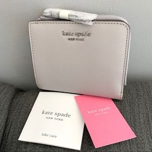 NWT Kate Spade genuine leather zip around wallet